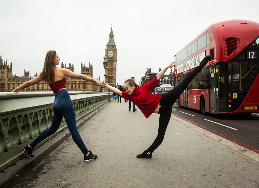 Two female dancers in front of big ben and london buses