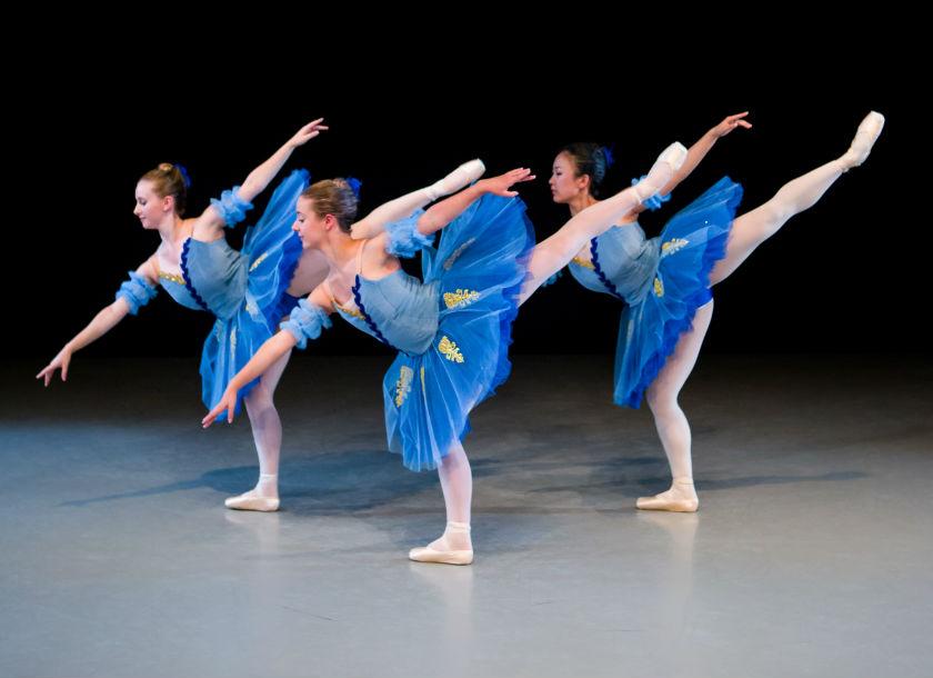 Trio of ballet dancers in blue tutus