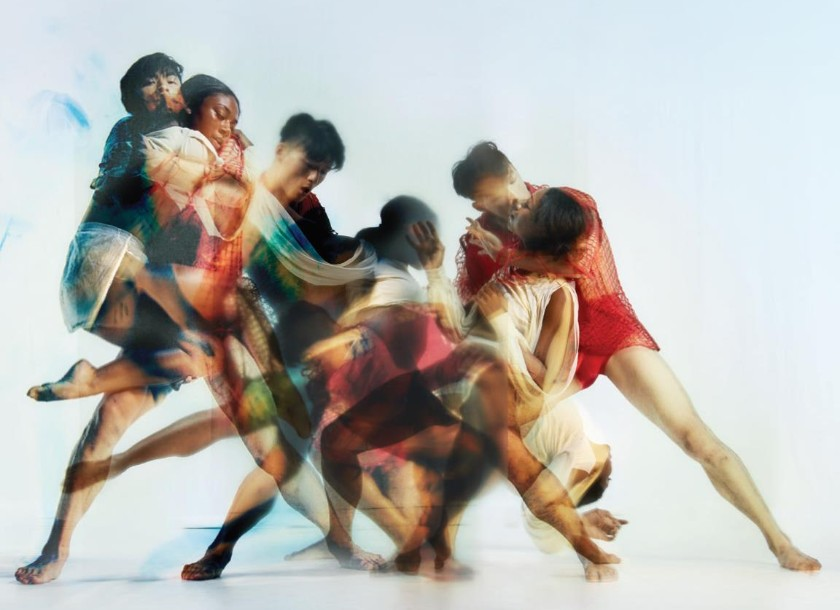Rambert2 dancers in blurred group graphic
