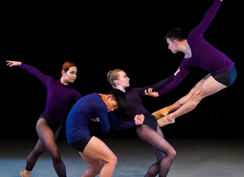 group of contemporary dancers in purple costumes